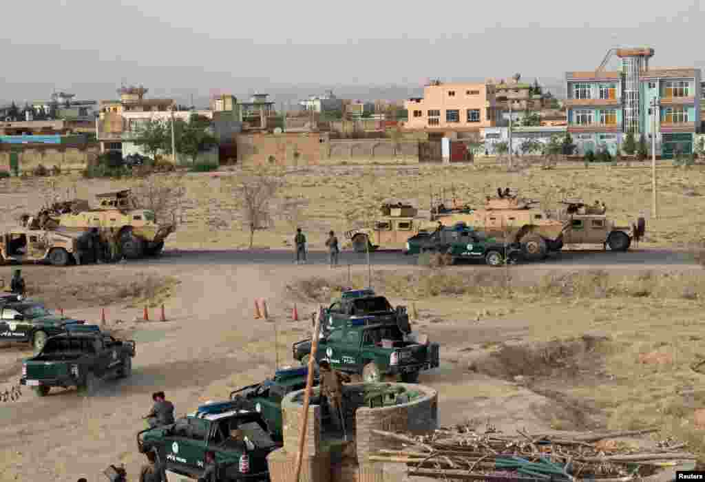 Afghan security forces take positions during a gunbattle in Kunduz city on September 29.
