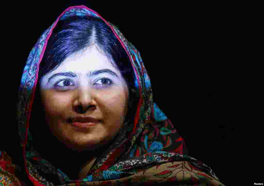 Pakistani teenager Malala Yousafzai, the joint winner of the 2014 Nobel Peace Prize, is shown after speaking at Birmingham library in Birmingham, England. Malala, who was shot in the head by the Taliban in 2012 for advocating girls' right to education, shared the prize with Indian campaigner against child trafficking and labor Kailash Satyarthi. (Reuters/Darren Staples)