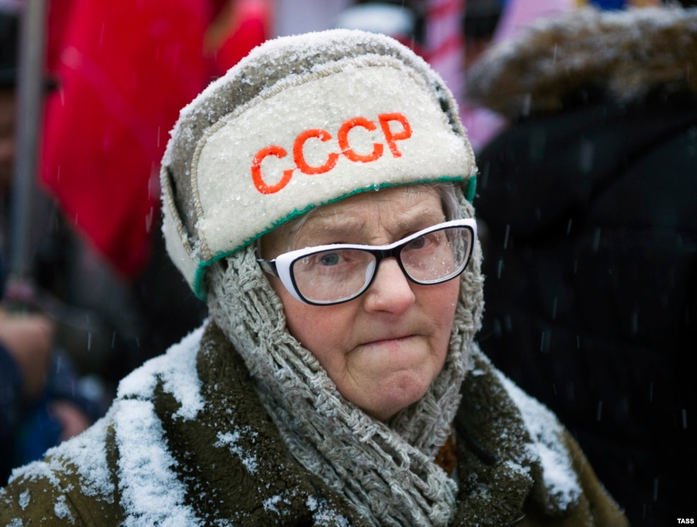 A Russian Communist Party supporter takes part in a march in Novosibirsk marking the 99th anniversary of the October Revolution. (TASS/Kirill Kukhmar)