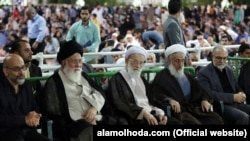 Iranian conservative cleric Ahmad Alamolhoda (2nd L) in a gathering in Mashhad, undated.