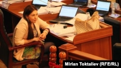 """""""I think most of my colleagues would not see the need to impose a dress code on journalists or other visitors to our building,"""" says Shirin Aitmatova, who represents the ruling Ata Meken party."""