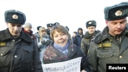 Interior Ministry officers detained Yevgenia Chirikova during a rally in Moscow last December. Now, she says, they are targeting her children.