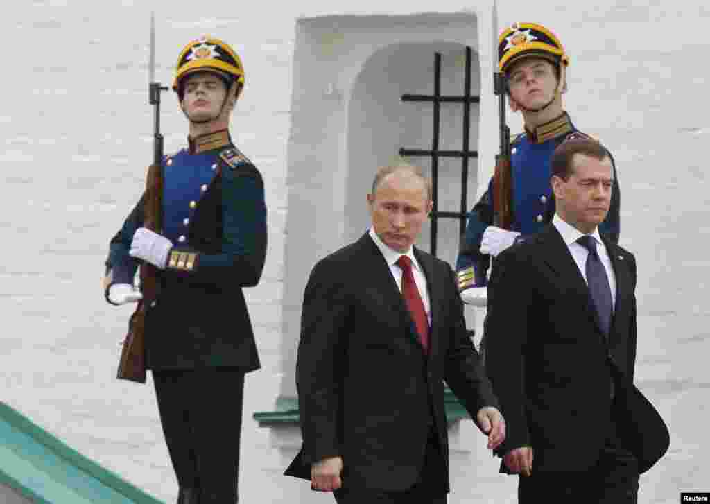 New Russian President Vladimir Putin (left) and former President Dmitry Medvedev after Putin's inauguration ceremony at the Kremlin. Putin appealed for unity in Russia amid ongoing protests against his continued rule. (Reuters/Dmitry Astakhov)