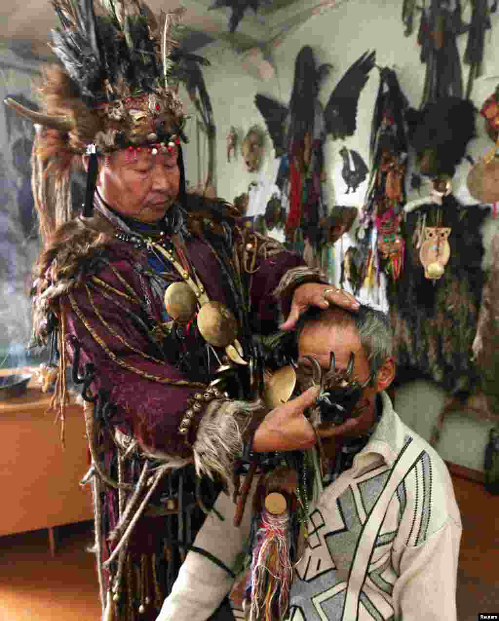 "Shaman Kara-ool Dopchun-ool uses a bear claw during a ritual to cure a man of asthma and liver disease. In an interview with The Siberian Times, the shaman explained: ""We don't set prices for our services.... People give us as much as they can. If a man is poor and can't give anything, he will still get help."""