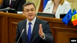 """Moldovan parliament speaker Igor Corman: """"This agreement is not against anyone. This is an agreement in favor of...the citizens of Moldova."""""""