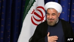 Iranian President Hasan Rohani gestures as he addresses his first news conference as president, on August 6 in Tehran.