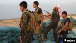 Tribal fighters take part in an intensive security deployment against Islamic State militants in Iraq's Anbar Province in late October.