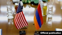 Armenia - U.S. and Armenian national flags placed on a negotiating table in Yerevan, 18Dec2013.