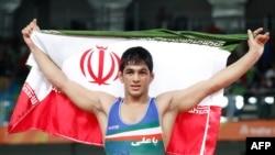Iran's Hassan Aliazam Yazdanicharati celebrates after winning against Russia's Aniuar Geduev in their men's 74kg freestyle final match.