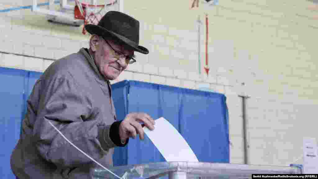 A man casts his ballot at a polling station in Kyiv on April 21.