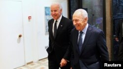 Israel's President Shimon Peres (right) walks with U.S. Vice President Joe Biden before their meeting at Peres' residence in Jerusalem in January.