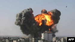 An explosion following an Israeli air strike in the southern Gaza Strip town of Rafah on January 13.