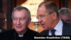 Russian Foreign Minister Sergei Lavrov (right) meets with Vatican Secretary of State Cardinal Pietro Parolin in Moscow on August 22.