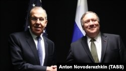 U.S. Secretary of State Mike Pompeo (right) shakes hands with Russian Foreign Minister Sergei Lavrov as they meet on the sidelines of the Arctic Council meeting on May 6.