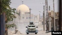 Сирия, броневик вооруженной оппозиции в городе Ракка, 18 июня 2017 года.