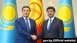 Премьер-министры Кыргызстана и Казахстана Мухаммедкалый Абылгазиев и Аскар Мамин. Бишкек. 12 июля, 2019.