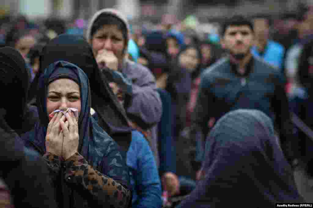 Shi'ite women weep as they listen to prayers outside the Mashadi-Dadash Mosque in Baku. Displays of mourning are made throughout the festival of Ashura, which reaches its peak on October 12.