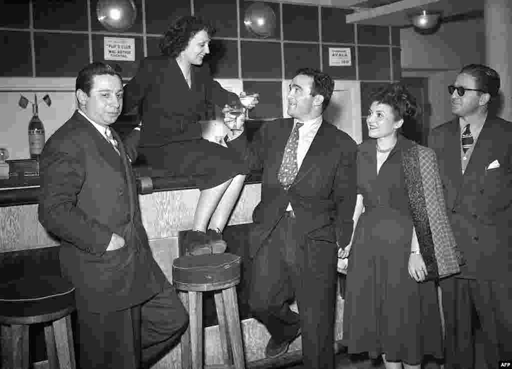 Piaf and French boxer Marcel Cerdan, the man who became the love of her life, in the Club des Cinq theater in Paris on March 17, 1948.