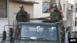 Войска на улицах города Джиср-эш-Шугур