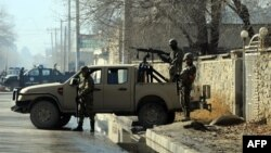Afghan security forces near the main gate of the National Directorate of Security, where an accidental explosion in an arms depot shook central Kabul in December
