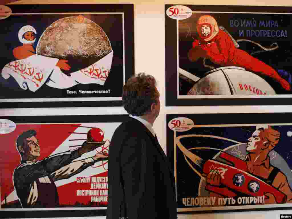 A visitor looks at an exhibit during the opening of an exhibition of Soviet space placards at the Museum of Modern Art in the Russian city of Krasnoyarsk on April 12, as  Russia celebrated the 50th anniversary  of Yury Gagarin's historic first space flight. Photo by Ilya Naymushin for Reuters