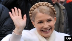 Ukraine's prime minister and presidential candidate Yulia Tymoshenko smiles as she greets people after casting her vote in her hometown of Dnipropetrovsk.
