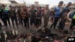 На месте взрывов в Садр-Сити (Багдад, 28 февраля 2016 года)