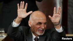 Afghan President Ashraf Ghani acknowledges applause while addressing a joint meeting of Congress at the Capitol in Washington on March 25.