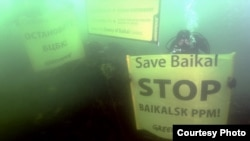 Greenpeace activists dive into Lake Baikal to protest a polluting paper mill