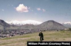 William Podlich strolls on a hillside outside of Kabul.