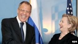 """U.S. Secretary of State Hillary Clinton and her Russian counterpart, Sergei Lavrov, were all smiles when she presented him with a mock """"reset button"""" in Geneva early last year."""
