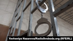 Handcuffs hanging on bars