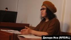 Шымкенттік белсенді Ардақ Әшім сотта отыр. Шымкент, 2 наурыз 2018 жыл.