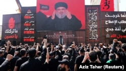 Lebanon's Hezbollah leader Sayyed Hassan Nasrallah gestures as he addresses his supporters via a screen during last day of Ashura, in Beirut, Lebanon September 20, 2018