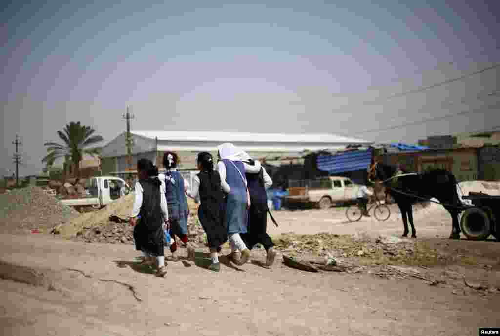 Girls walk home from school in the Al-Fdhiliya district of eastern Baghdad.
