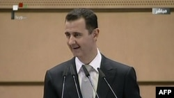 Syrian President Bashar al-Assad gives a speech in Damascus on January 10.