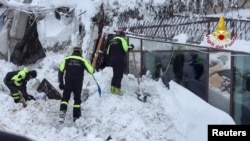 Rescue workers look foir survivors of an avalanche at the Hotel Rigopiano in Farindola, Italy on January 20.