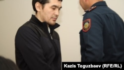 Sayan Khayrov (left) appears in Kazakh court on October 16