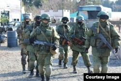 """Japanese """"airsoft"""" players dressed in the uniforms of the notorious """"little green men"""" -- unmarked Russian soldiers involved in the 2014 annexation of Crimea."""