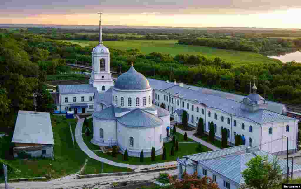 """The Divnogorsk Assumption Monastery stands just 2 kilometers from the chalk temple. Father Aleksei, the rector of the monastery, told RFE/RL's Russian Service that his monastery was the owner of the temple before the 1917 Bolshevik Revolution and that if ownership is returned to it the temple will remain open to tourists free of charge and """"all operating conditions will be strictly observed"""" to ensure its preservation."""