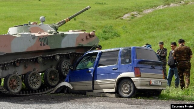 A tangle between a car with Kyrgyz license plates and an Uzbek tank in the Sokh enclave in 2010.