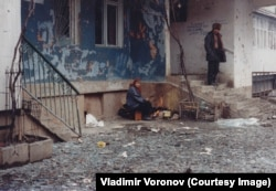 Residents venture out near Lenin Avenue during a lull in the bombing.