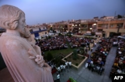 Iraqi Christians who fled the violence in Mosul attend a Mass in Irbil on May 31.