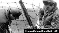 HUNGARY – Hungarian border guards cut through the barbed wire frontier with Austria and the Free West near Hegyeshalom some 50 kilometers east of Vienna on May 2, 1989.