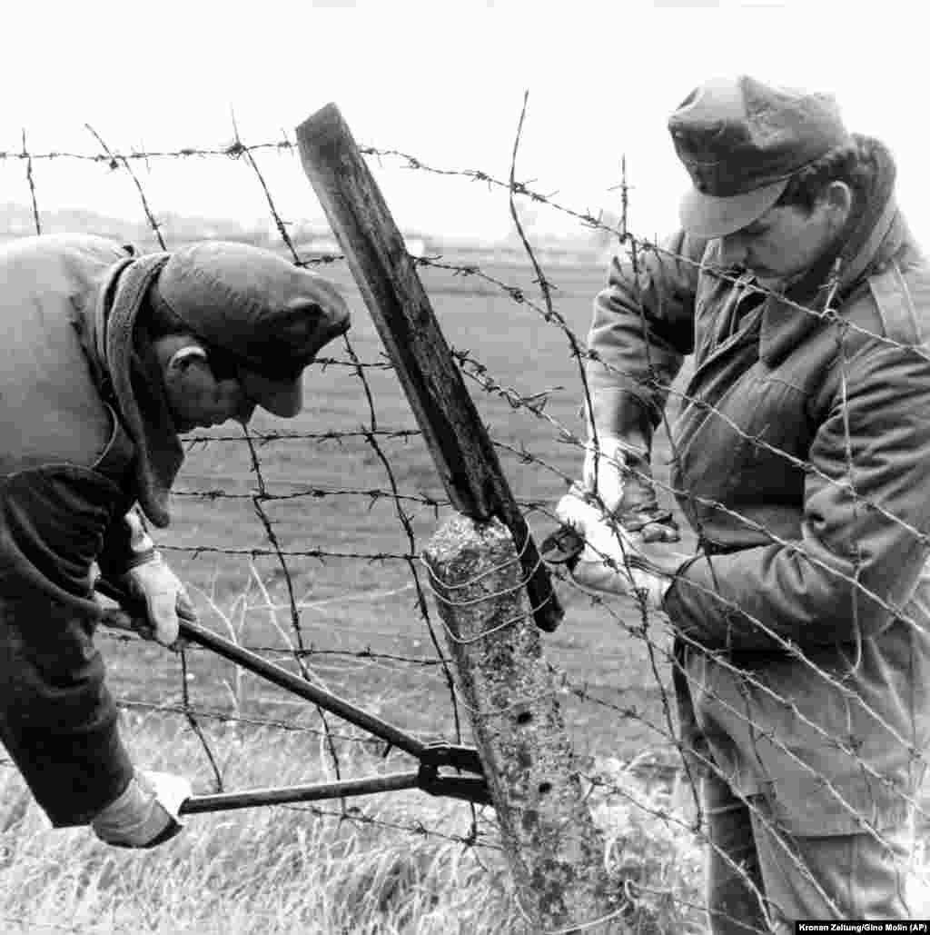 Several months earlier, Hungarian border guards began dismantling the barbed wire fence at the Austrian border near Hegyeshalom, some 50 kilometers east of Vienna. The removal of a section of border fence in May 1989 was a symbolic first step as Hungary prepared to ease travel restrictions to the West.