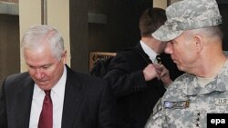U.S. Secretary of Defense Robert Gates (left) with U.S. Army Lieutenant William Caldwell IV, commander of NATO Training Mission Afghanistan, at Camp Eggers in Kabul on December 9