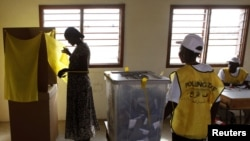 A south Sudanese woman votes at a polling station during the referendum in Juba on January 9.