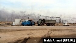 دخان معامل الطابوق تغطي سماء بغداد