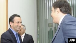 U.S. Assistant Secretary of State Phillip Gordon (left) being greeted by Georgian President Mikheil Saakashvili in Tbilisi in June.