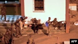 Forces loyal to Alassane Ouattara prepare to attack the presidential palace in Abidjan on April 1.